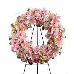 Corona funebre di fiori rosa
